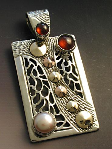 Rectangular pierced wave pendant